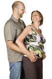 Pregnant couple looking at each other smiling Stock Photography