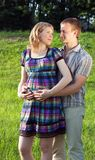 Pregnant couple in love royalty free stock photography