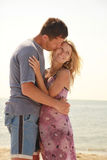 Pregnant couple in love on the beach Royalty Free Stock Photography
