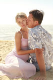 Pregnant couple in love on the beach Royalty Free Stock Photo