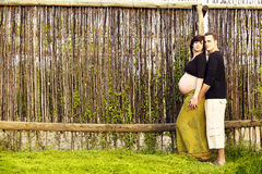 Pregnant couple outdoors Royalty Free Stock Photos