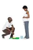 Pregnant couple with paint tin Stock Photo