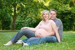Pregnant couple in the park Stock Photo