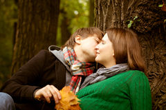 Pregnant couple in  the park. Pregnant couple  wearing green sweaters relaxing in the park Royalty Free Stock Photography