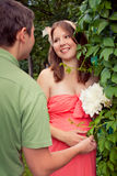 Pregnant couple in the park. Relaxing Stock Images