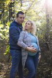 Pregnant couple in the park. Young pregnant couple in the park Stock Photos