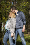Pregnant couple in the park. Young pregnant couple in the park Stock Images