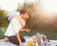 Pregnant couple on picnic. In the park Royalty Free Stock Image