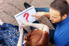 Pregnant couple plans a date of baby birth with the calendar. Royalty Free Stock Photo