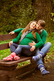 Pregnant couple relaxing on the bench Royalty Free Stock Photography