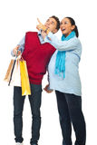 Pregnant couple at shopping pointing up. Happy couple at shopping ,pregnant wife showing something to her husband and pointing up isolated on white background Royalty Free Stock Photography