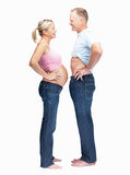 Pregnant couple standing face to face over white Stock Photo