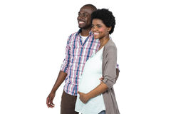 Pregnant couple standing together Stock Image