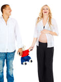 Pregnant couple with toy bear Royalty Free Stock Images