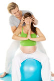 Pregnant couple and yoga Royalty Free Stock Photos