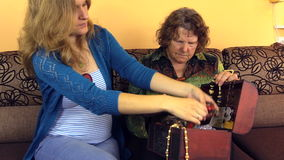 Pregnant daughter with old senior woman size jewelry stock video footage