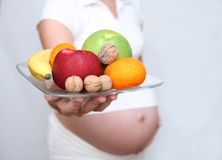 Pregnant and diet 2 stock photography
