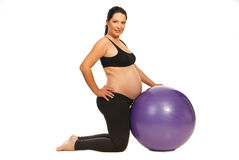 Pregnant doing exercises Royalty Free Stock Images
