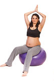 Pregnant doing fitness Stock Image