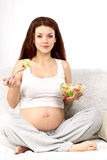 Pregnant eats Royalty Free Stock Image