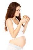 Pregnant eats sandwich Stock Image