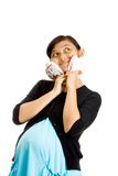 Pregnant ethnic woman with two pairs of baby shoes Stock Image