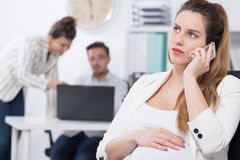 Pregnant exec and business call Stock Images