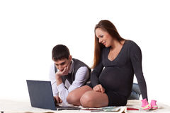 Pregnant family with money. Family budget. Royalty Free Stock Images