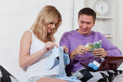 Pregnant family with money. Family budget. Stock Image