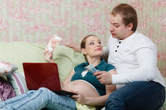 Pregnant family with money. Family budget. Stock Photo