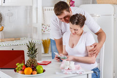 Pregnant family with money. Family budget. Stock Images