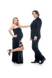 Pregnant fashion woman and husband in gangsta style Stock Images