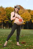 Pregnant female & autumn Royalty Free Stock Images