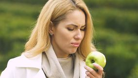 Pregnant female with big belly biting apple, suffering toxicosis, feeling sick. Stock footage stock video