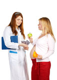 Pregnant female and doctor Royalty Free Stock Photo