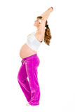 Pregnant female doing fitness exercises Royalty Free Stock Images