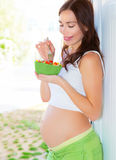 Pregnant female eat fruits Royalty Free Stock Image