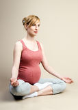 Pregnant female is engaged in yoga Royalty Free Stock Photo