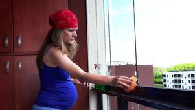 Pregnant female girl clean dust in flat house loggia stock video footage