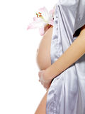 Pregnant female holding belly and flower Stock Image