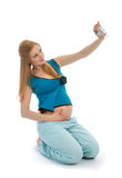 Pregnant female make selfportrait Royalty Free Stock Images