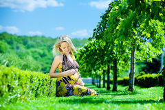 Pregnant female in park. Beautiful pregnant female in park stock photos