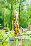 Pregnant female in park. Beautiful pregnant female in park royalty free stock photos