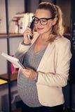 Pregnant female at work stock photos
