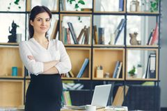 Pregnant business woman working at office motherhood standing looking camera confident royalty free stock photo
