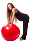 Pregnant fitness woman doing exercise on fitball on white background Royalty Free Stock Image
