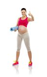Pregnant fitness woman isolated on white Stock Photography