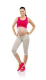Pregnant fitness woman isolated on white Stock Photos