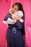 Pregnant girl. Embrace toy bear Royalty Free Stock Images