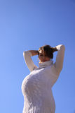 Pregnant girl against the sun royalty free stock image